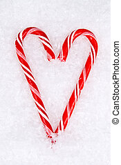 Christmas Candy Canes - Two Christmas candy canes resting in...