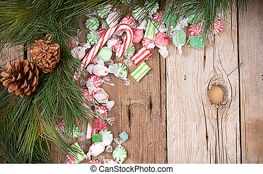 Christmas candy on wooden background