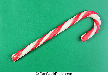 christmas cane on green background