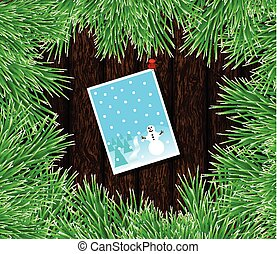 Christmas Card Pinned on Wood with Green Fir