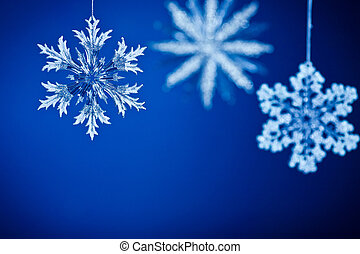 Christmas card. Snowflakes on blue background