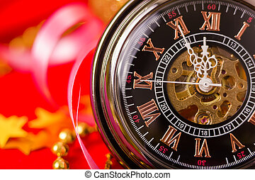 Christmas card. vintage watch on a red background with golden de