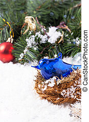 Christmas card with blue bird in nest