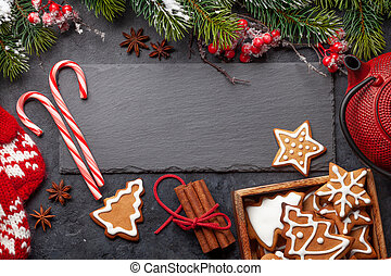 Christmas card with gingerbread cookies and tea