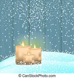 Christmas card with group of candles in snow on wooden backgroun
