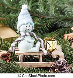 Christmas card with snowman on sled