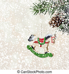 Christmas card with wooden hourse on fir branches with snow deco