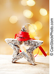 Christmas Card with wooden toy in a shape form and red ribbon on abstract defocused bokeh background. Xmas concept, poster, banner