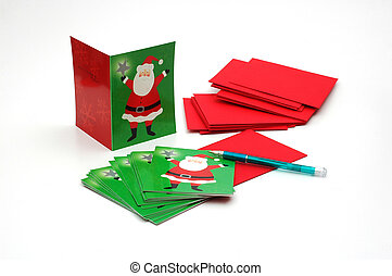 Christmas Cards - Christmas cards and pen isolated on a...