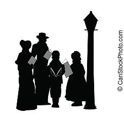 family in silhouette singing carols under old street lamp