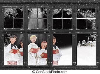 Christmas carolers in frosty windowpane