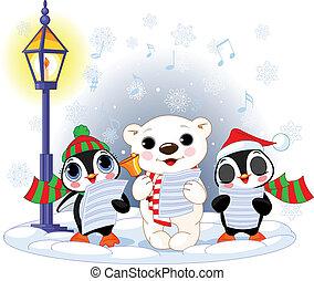 Christmas carolers %u2013 cute polar bear and two penguins- under streetlight