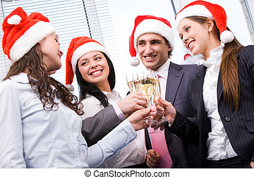 Christmas cheers - Image of cheering friends in Santa caps...