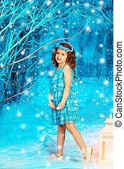 Christmas child girl on winter tree background, snow, snowflakes border