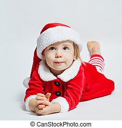 88f205e9b10fd Christmas child in Santa hat looking up and dreaming on Christmas gift on  white background