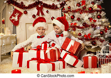 Christmas Children Opening Present Gift Box, Kids Boys in Santa Hat, Xmas Tree Interior