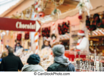 Christmas chocolate at Christmas market in France blur, bokeh, defocused