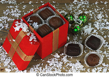 Christmas chocolate candies in winter snow - Chocolate...