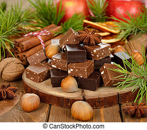 Christmas chocolate fudge on brown background