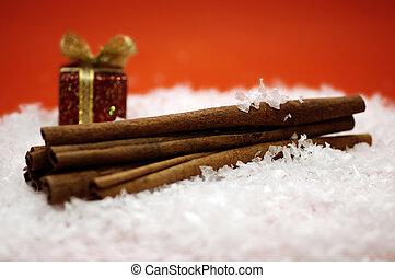 Christmas Cinnamon - Cinnamon sticks and christmas present ...