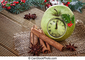 Christmas clock  in an apple with winter decoration