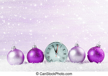 Christmas clock with Christmas balls. Shallow depth of field