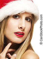 christmas closeup of a glamorous woman wearing santas hat on white background