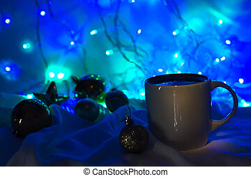 Christmas coffee cup with new year decorations on background.