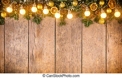 Christmas colored lights with decoration on wood