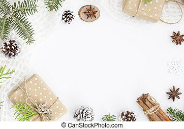 Christmas composition. Christmas hand made gift box, pine cones, fir tree branches, cinnamon sticks, anise star on white background. Top view, flat lay, copy space. hero header mockup