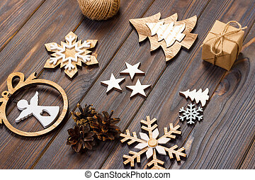 Christmas composition. Christmas snowflakes, Christmas tree and angel in a frame on a wooden background. New Year wooden decorations