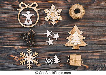 Christmas composition. Christmas snowflakes, Christmas tree and angel in a frame on a wooden background. New Year wooden vintage decorations