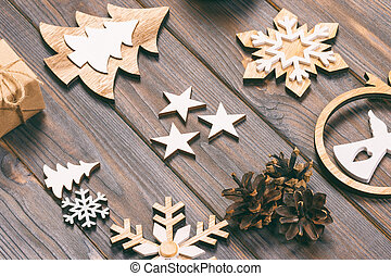 Christmas composition. Christmas snowflakes, Christmas tree and angel in a frame on a wooden background. New Year wooden decorations. Toned