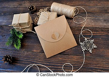 Christmas Composition set of gift kraft boxes, textile toys and rope on wooden background