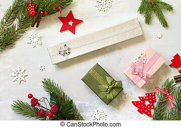 Christmas composition, winter, new year concept. Present, Branches of spruce and red decorations.Top view flat lay. Free space for your text.