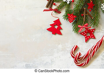 Christmas composition, winter, new year concept. Sweets, branches of spruce and red decorations.Top view flat lay. Free space for your text.