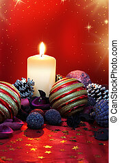 Christmas composition with candle and colored potpourri