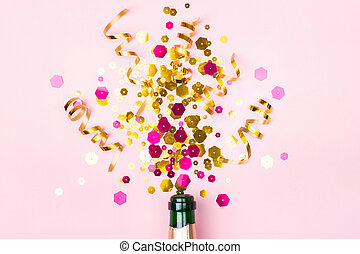 Christmas composition with champagne bottle golden sparkles on pastel pink background. Holiday creative concept