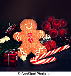 Christmas composition with Christmas gift, Gingerman cookie,...