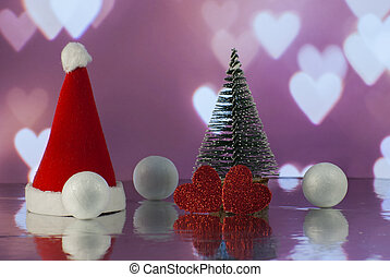Christmas composition with Christmas tree, Santa claus cap, gift or present box against holiday lights background