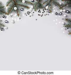 Christmas composition with fir branches tree, silver balls on grey background. Merry Xmas card. Winter holiday. Happy New Year.