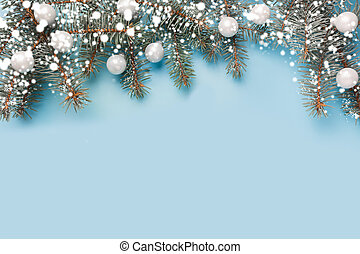 Christmas composition with fir branches tree, silver balls on pastel blue background. Merry Xmas card. Winter holiday. Happy New Year.