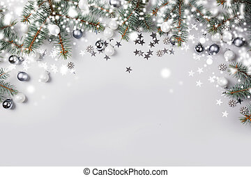 Christmas composition with fir branches tree, silver balls on pastel light background. Merry Xmas card. Winter holiday. Happy New Year.