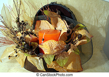 Christmas composition with leafs and candle