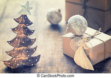 Christmas Composition with present box festive decorations on wooden background