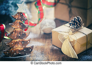 Christmas Composition with present boxes, festive decorations on wooden background