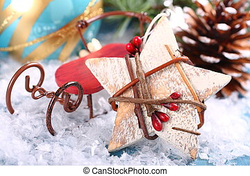 Christmas composition with wooden star and sleigh