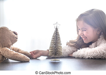 Christmas concept, little girl with her toys
