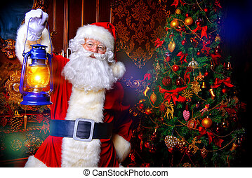 Portrait of a fairytale Santa Claus standing with lantern in...