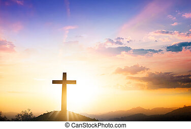 Christmas concept: The cross on mountain sunset background